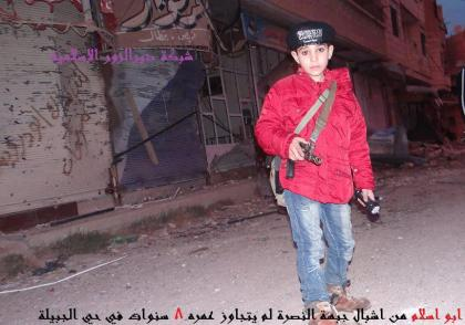 8-years old child recruited by Nusra in Syria