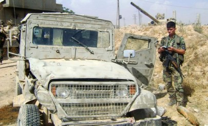 A handout photograph distributed by Syria's national news agency SANA shows a vehicle which it says is an Israeli military vehicle being used by rebel fighters in Qusair near Homs city