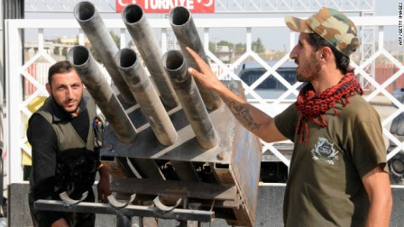 121005032319-syria-rebels-rocket-launcher-story-top