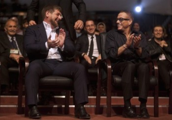 Chechen President Kadyrov and Belgian actor Van Damme share a joke during a ceremony to mark Kadyrov's 35th birthday in the Chechen capital Grozny