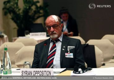 Senior Syrian opposition member Haitham al-Maleh sits alone during the second session of the Geneva-2 peace conference in Montreux