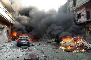 De autobommen die dood en vernieling veroorzaakten in Karm al-Loz in Homs op 9 april 2014.