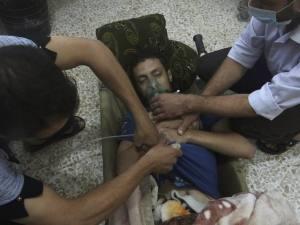 Een slachtoffer van de gifgasaanval nabij de Syrische hoofdstad Damascus van 21 augustus 2013. (Foto: Reuters)